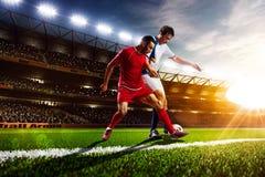 Jugadores de fútbol en panorama de la acción Fotografía de archivo libre de regalías