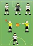Jugadores de fútbol y árbitros. Foto de archivo