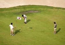 Jugadores de golf Imagen de archivo libre de regalías