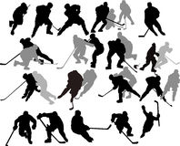 Jugadores de hockey del vector - siluetas. Imágenes de archivo libres de regalías
