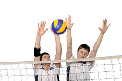 Jugadores de voleibol con la bola Imágenes de archivo libres de regalías