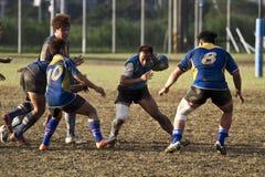 Jugadores del juego de rugby Imágenes de archivo libres de regalías