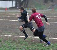 Jugadores del rugbi en la acción Fotos de archivo