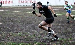 Jugadores del rugbi en la acción Imagen de archivo