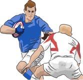 Jugadores del rugbi que se ejecutan con la bola Imagen de archivo