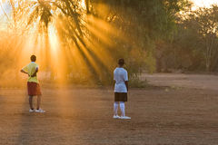 Jugadores en la puesta del sol Imagenes de archivo
