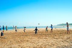 Jugando en la playa, Bali Imagen de archivo libre de regalías