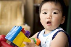Jugar al bebé Imágenes de archivo libres de regalías