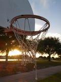 Jugar aros en la puesta del sol Fotos de archivo libres de regalías