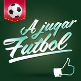 A jugar Futbol - Lets play soccer spanish text Royalty Free Stock Images