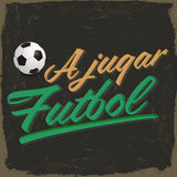 A jugar Futbol - Lets play soccer spanish text Stock Photo