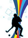 Jugar a hockey Foto de archivo libre de regalías