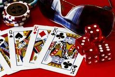 Jugar a tarjetas y corta en cuadritos Fotos de archivo