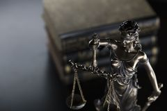 Jugde concept. Statue of justice and books in judge office stock photography