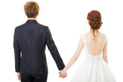 jugeant des jeunes mariés de mains d'isolement sur le blanc Photos libres de droits