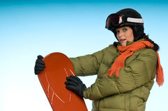 jugeant le femme orange de snowboard jeune images stock