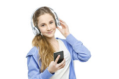 Jugendlich Altersmädchen mit Kopfhörern Stockfotos