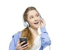 Jugendlich Altersmädchen mit Kopfhörern Lizenzfreie Stockbilder