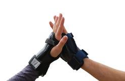 Jugendlich Arme im Handgelenkabdeckunggruß Lizenzfreies Stockbild