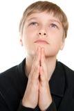 Jugendlich betet zum Gott. Stockbilder