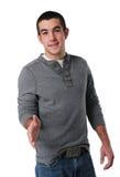 Jugendlich Jungengruß mit seiner Hand Stockfotografie