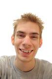 Jugendlich Lachen mit Klammern Stockfoto