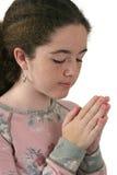 Jugendlich Mädchen, das 2 betet Lizenzfreie Stockfotografie