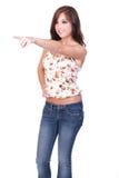 Jugendlich Mädchen, das weg nach links zeigt Stockfotos
