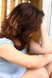 Jugendlich Mädchen drückte nieder Stockfotos
