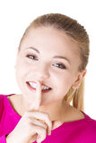 Jugendlich Mädchen mit dem Finger auf ihren Lippen. Lizenzfreies Stockfoto
