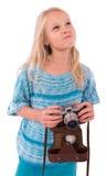 Jugendlich Mädchen mit Retro- Kamera auf einem weißen Hintergrund stockbilder