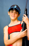 Jugendlich Mädchen und Gewehr Stockbild