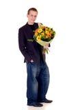 Jugendlich mit Blumenstrauß der Blumen Lizenzfreie Stockfotos