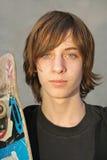 Jugendlich Schlittschuhläuferjunge Stockfoto
