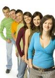 Jugendliche in der Zeile Stockbilder