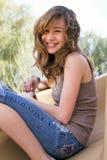 Jugendliche Frau auf Spielplatz-Plättchen Lizenzfreie Stockfotografie
