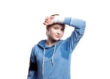 Jugendliche im blauen Sweatshirt Atelieraufnahme, lokalisiert Lizenzfreies Stockfoto