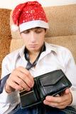 Jugendlicher überprüft die Geldbörse Stockfotografie