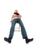 Jugendlicher in der Schutzkappe von Weihnachtsmann Lizenzfreies Stockfoto
