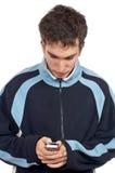 Jugendlicher, der sms sendet Lizenzfreie Stockbilder