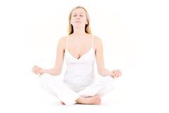 Jugendlicher in der Yogahaltung Stockbild