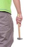 Jugendlicher hält einen Hammer an Stockbild