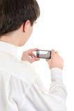 Jugendlicher machen ein Foto mit einem Mobiltelefon Stockfotos