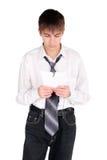 Jugendlicher mit heftigem Papier Stockbild