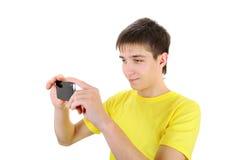 Jugendlicher mit Mobiltelefon Stockbilder