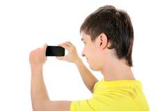 Jugendlicher mit Mobiltelefon Stockfoto
