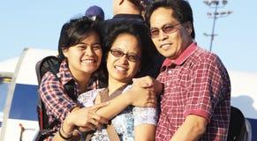 Jugendlicher mit Mutter und Vater Stockbild
