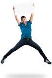 Jugendlichjunge, der leeres Papier springt und hält Lizenzfreie Stockfotografie