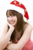 Jugendlichmädchen, das einen Weihnachtshut trägt lizenzfreie stockfotos