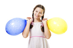 Jugendlichmädchen, das mit Ballons steht Lizenzfreie Stockfotos